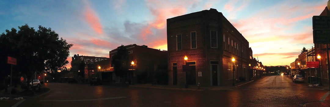 Sunset on Downtown Nacogdoches by Bruce Partain